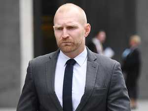 Former cop cleared of downgrading mate's charge