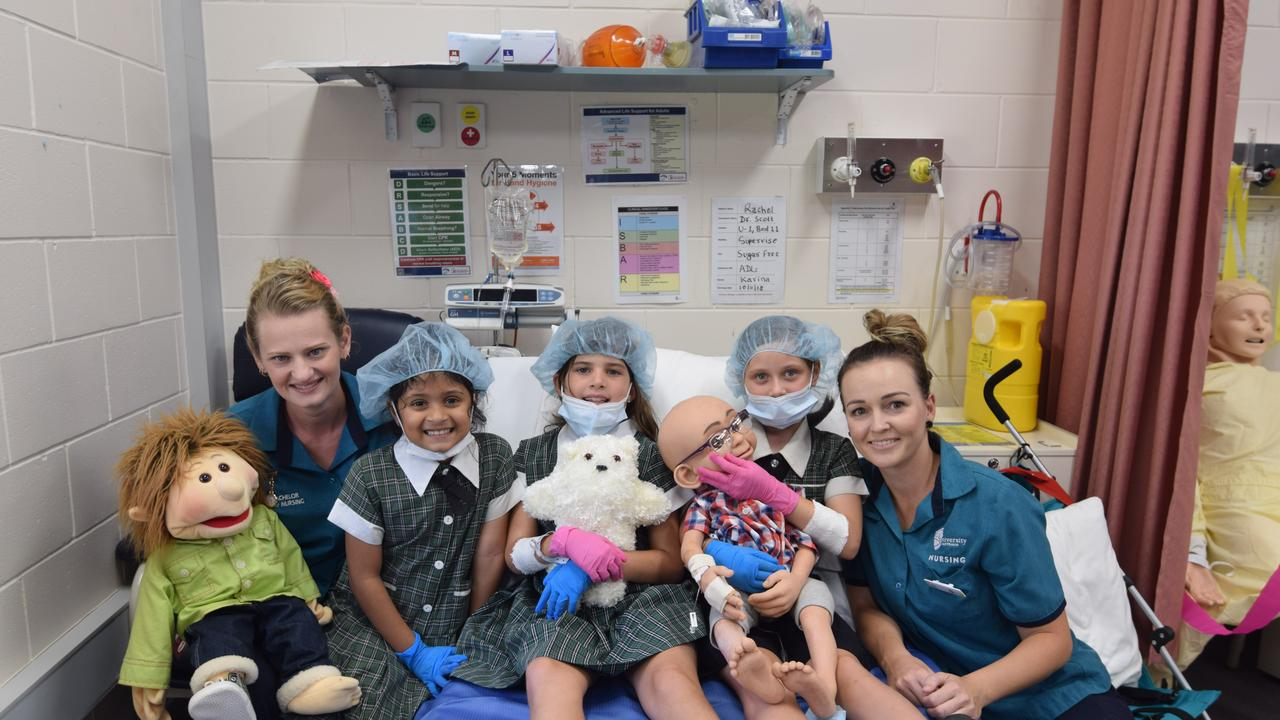 READY TO OPERATE: Christine Fleming, Shamira Khan, Sophie Martin, Peyton Russo and Angel Loader are all smiles in the set-up hospital ward.