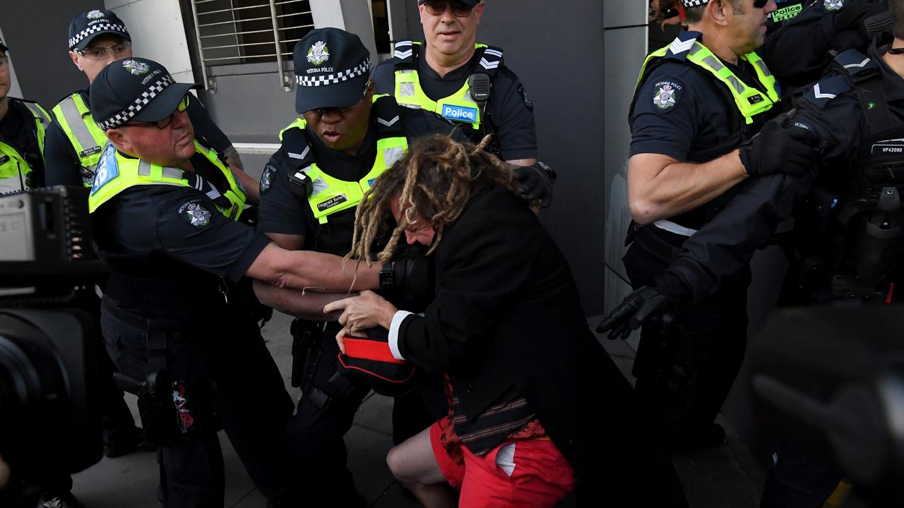 Police lead a protester away. Picture: AAP Image/James Ross