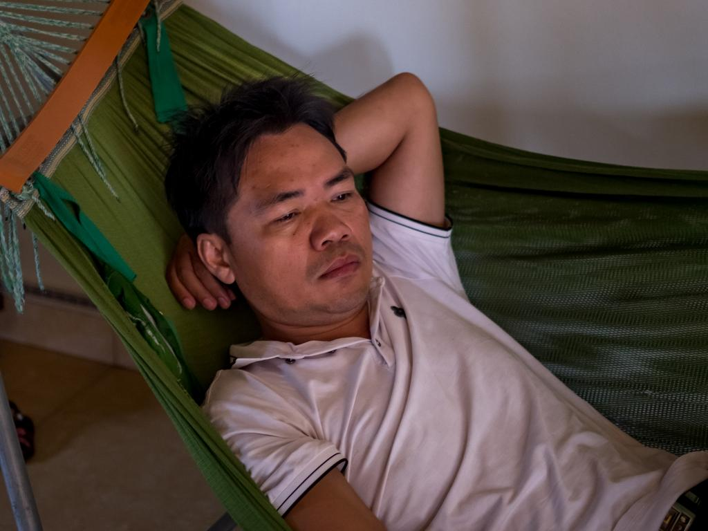 Nguyen Dinh Tinh, 40, brother of Nguyen Dinh Tu, who is believed to be one of 39 victims found dead in a refrigerated truck in Britain rests at home as he worries for his brother. Picture: Linh Pham/Getty Images.