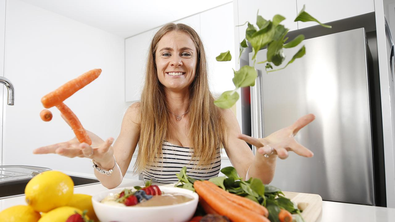 Prue McAuliffe posing at her home in Bowen Hills, she changed to vegan and a plant based diet. (AAP Image/Josh Woning)