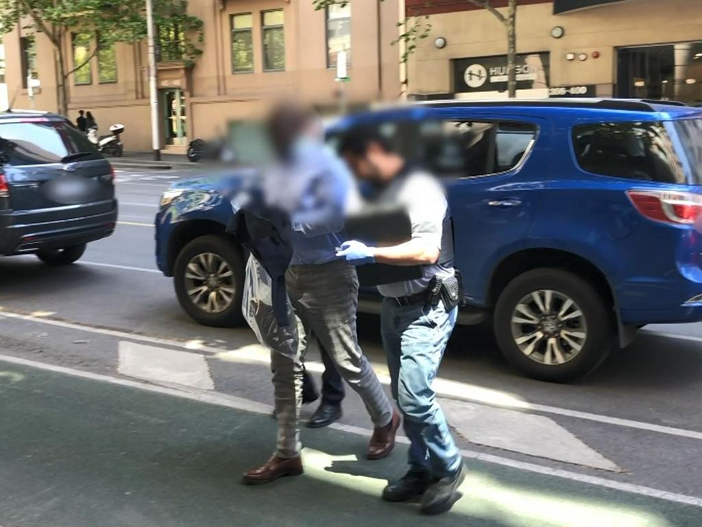 The man being taken into Melbourne's AFP headquarters. Picture: AFP