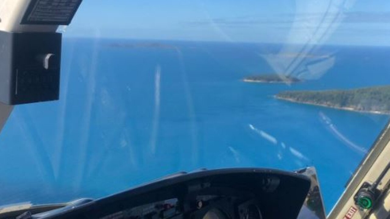 Rescue chopper headed to Airlie Beach to airlift people bitten by a shark. Picture: RACQ CQ Rescue/Twitter