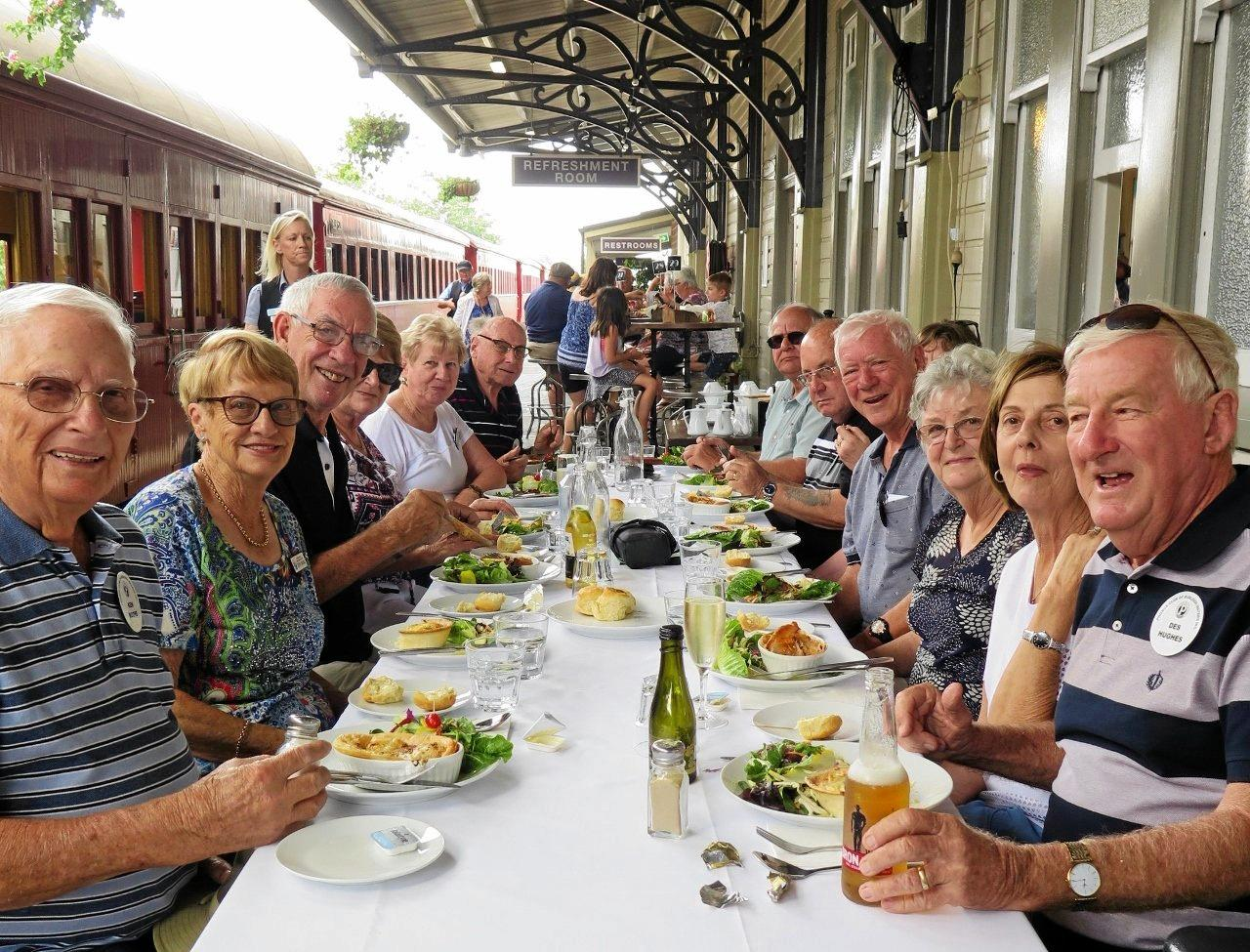 Burleigh Waters Probus group having lunch on Gympie Railway Station platform after riding the Mary Valley Rattler.
