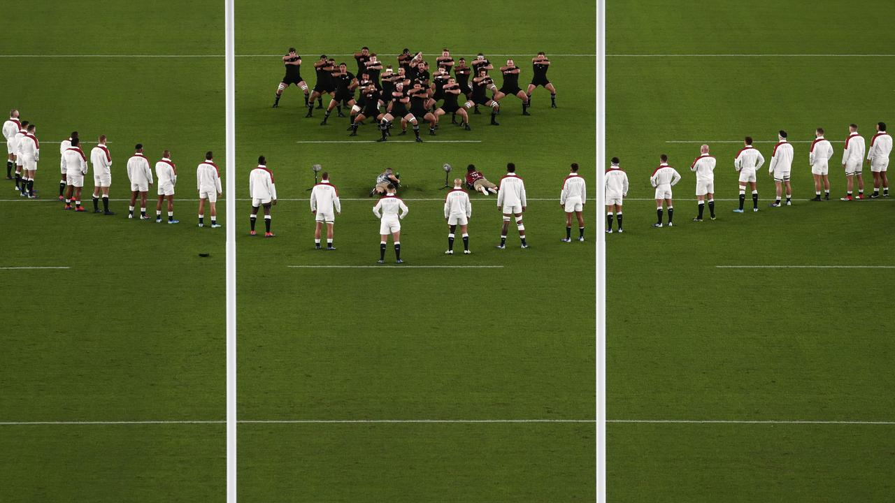 In this file photo taken on October 26, 2019, England's players look on in a V-shaped formation as New Zealand's players perform the haka before the Japan 2019 Rugby World Cup semi-final match between England and New Zealand at the International Stadium Yokohama in Yokohama. – England have been fined for encroaching on New Zealand's haka in a provocative V-shaped formation before last weekend's W