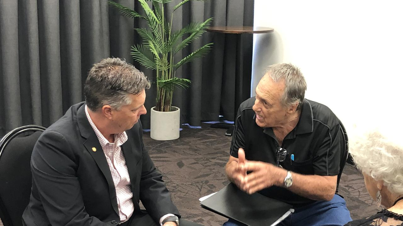 Retiree Frank Senica, 82, chats to Chair of the Health Committee and Member for Thuringowa, Aaron Harper MP at GECC following the Gladstone public hearing for the inquiry into aged care, end-of-life and palliative care, and voluntary assisted dying.