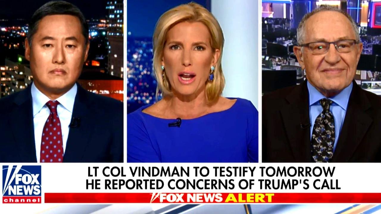 "John Yoo's (left) use of the word ""espionage"" on live TV has sparked a bitter debate. Picture: Fox News"