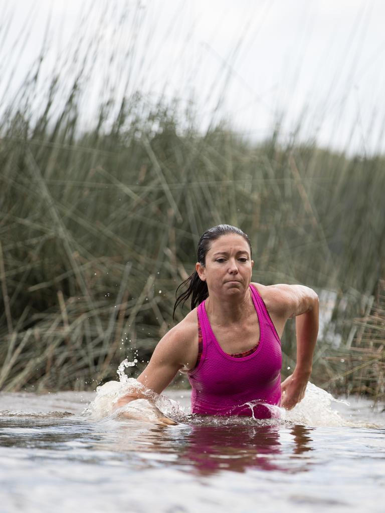Kate Clark, an extreme racing and True Grit competitor, trains in Ewen Maddock Dam. Picture: David Kelly