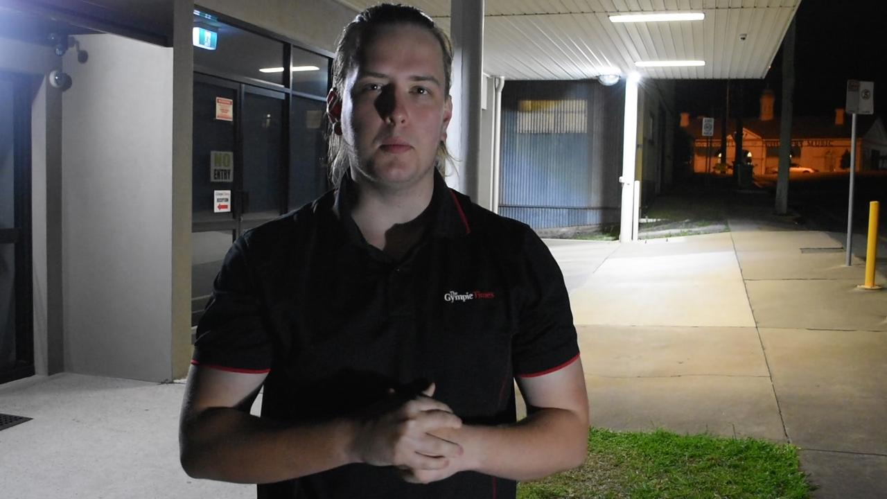 "Josh Preston stands outside the Gympie Times office during a ""paranormal investigation""."
