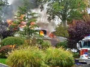 Plane crashes into suburban home