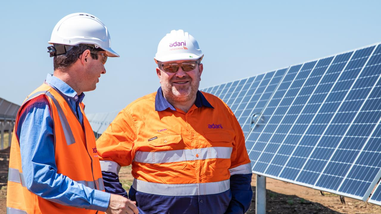 SITE INSPECTION: Adani CEO Lucas Dow and Adani Renewables Manager Ian Sedgman visiting the Rugby Run Solar Farm visit during the mechanical completion event in November last year.
