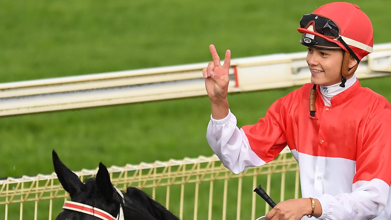Michael Murphy gestures after riding Prioritise to victory in race 9, the Open Handicap, during Saturday race day at Doomben Racecourse in Brisbane, Saturday, September 29, 2018. (AAP Image/Albert Perez)
