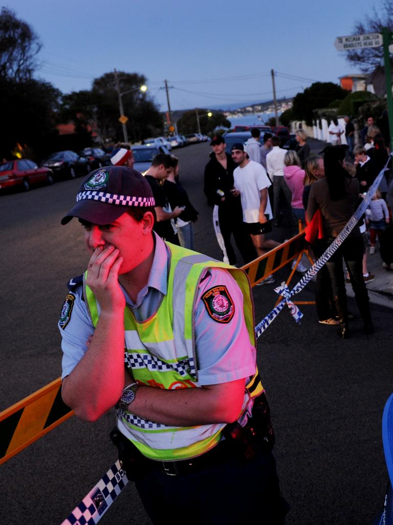 A police officer patrols a cordon as the drama unfolds.