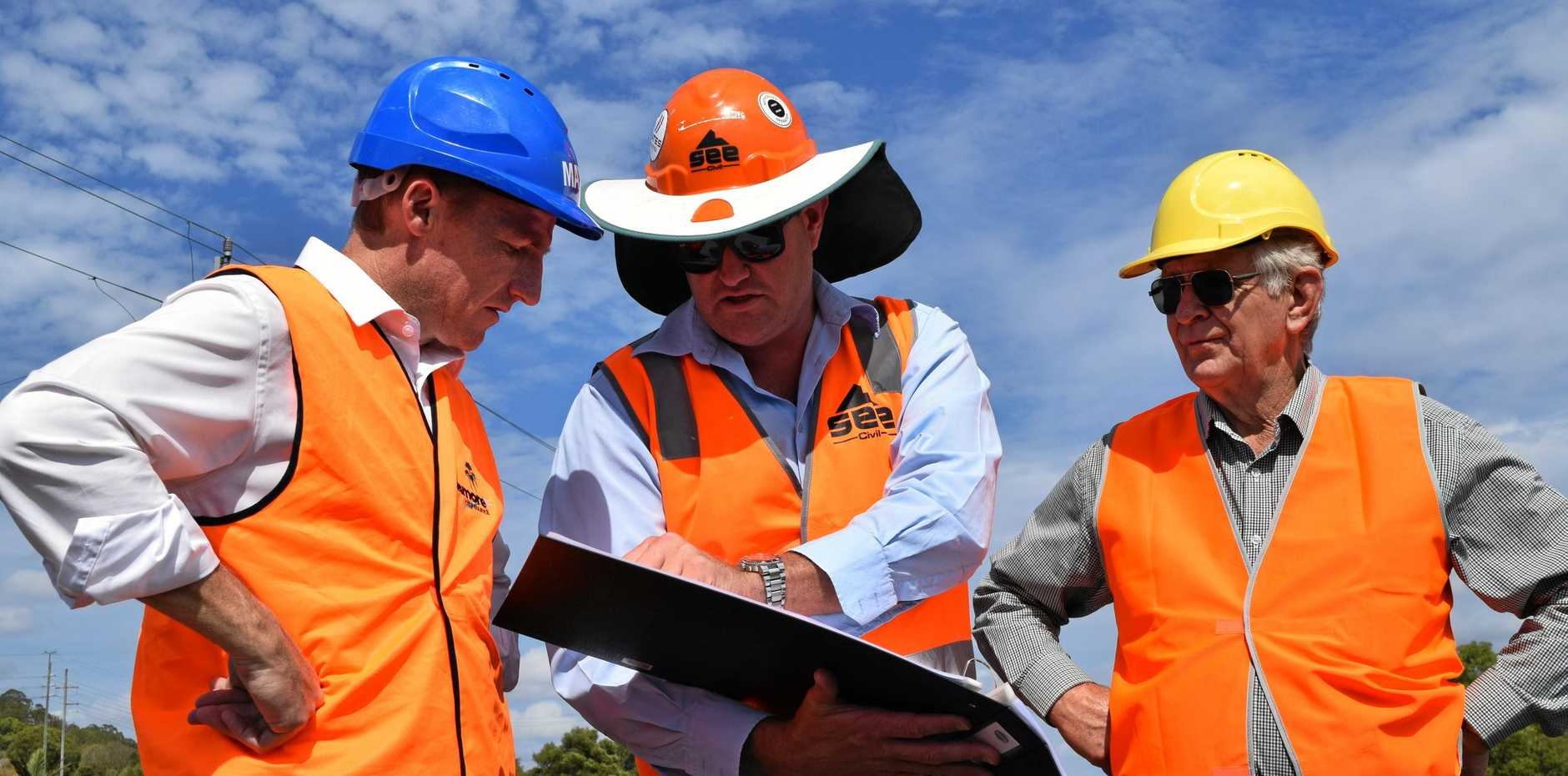 WORK UNDERWAY: Lismore City Council mayor Isaac Smith, SEE Civil project manager Michael Williams and Cr Bill Moorhouse inspect the earthworks of the South Lismore Flood Mitigation project.