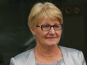 Mum in court over allegation she helped Mackay fugitive flee
