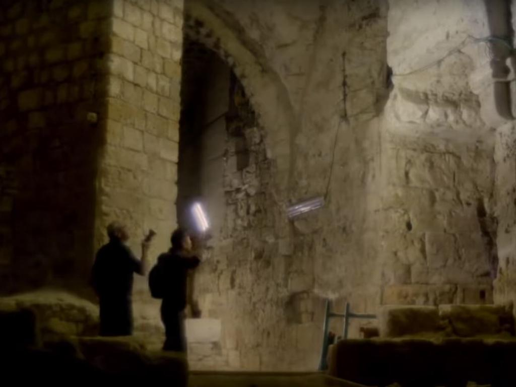 Presenter and archaeologist Albert Lin with Israel Antiquities researcher Dr Eliezer Stern inside the Templar crypt under the city of Acre. Picture: National Geographic