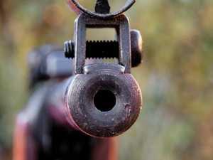 'F--- off you c---': Masked gunmen still on run in Gympie
