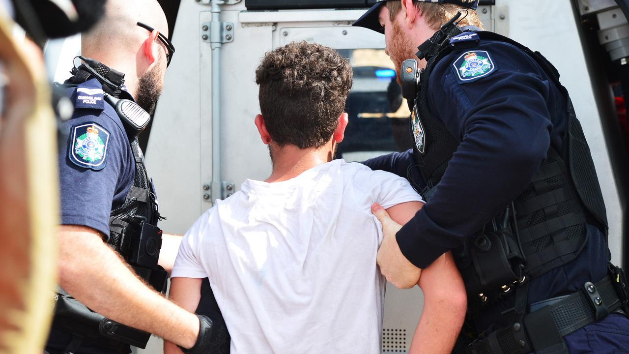 A young male is arrested by police on Queens Road, Hermit Park after stealing a car with three other juveniles. Picture: Zak Simmonds