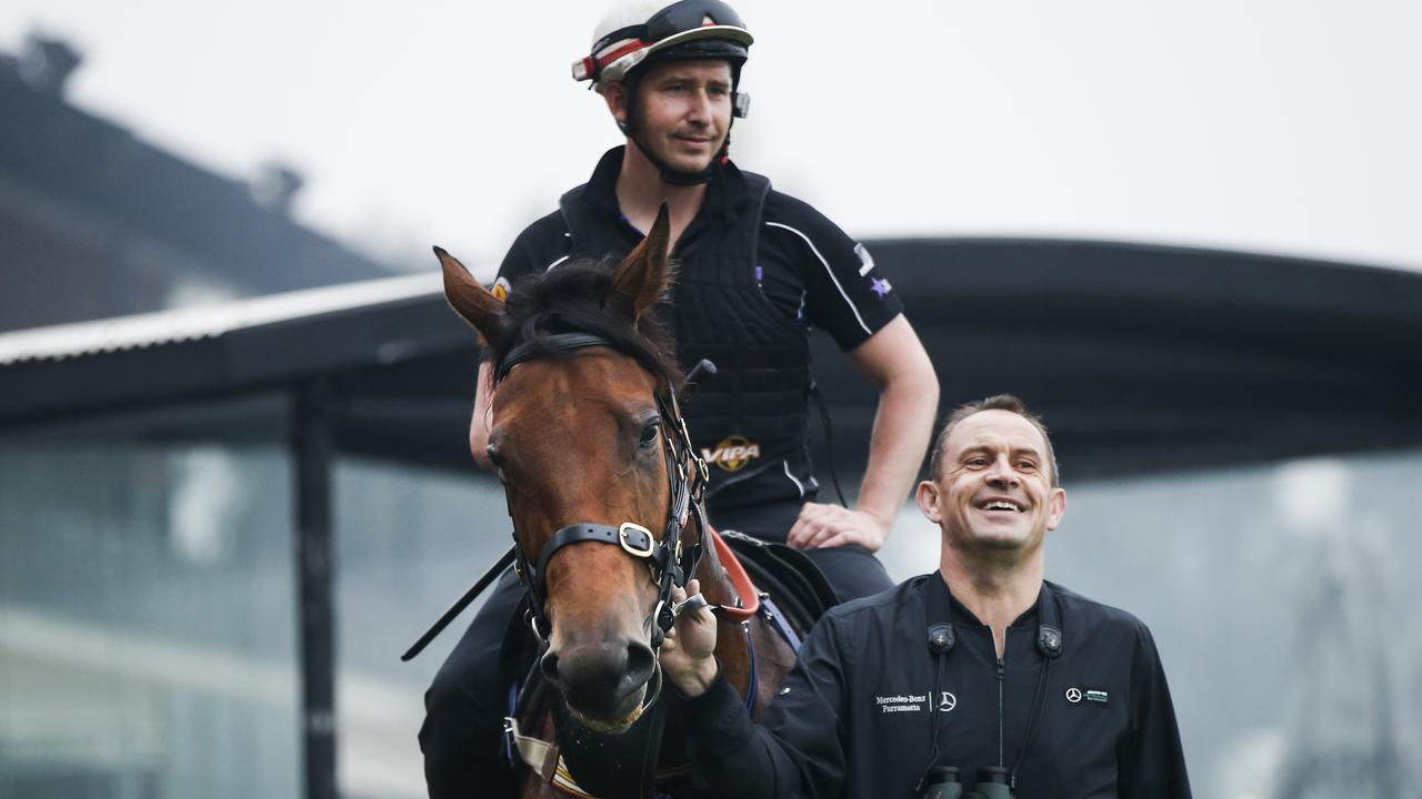Trainer Chris Waller (right) with Kolding, during track work at Rosehill Gardens ahead of this weekend's Golden Eagle. Picture: Dylan Robinson