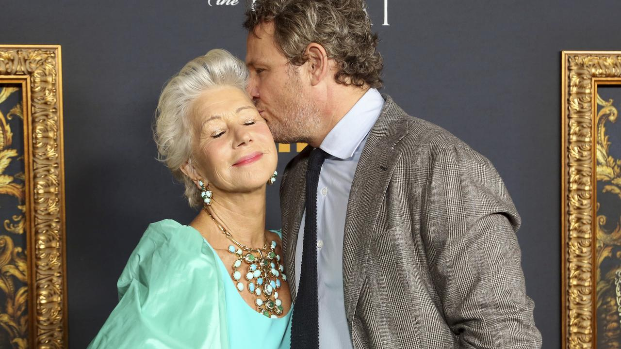 Jason Clarke kisses Dame Helen Mirren as they arrive at the LA Premiere of Catherine the Great. Picture: Willy Sanjuan/Invision/AP