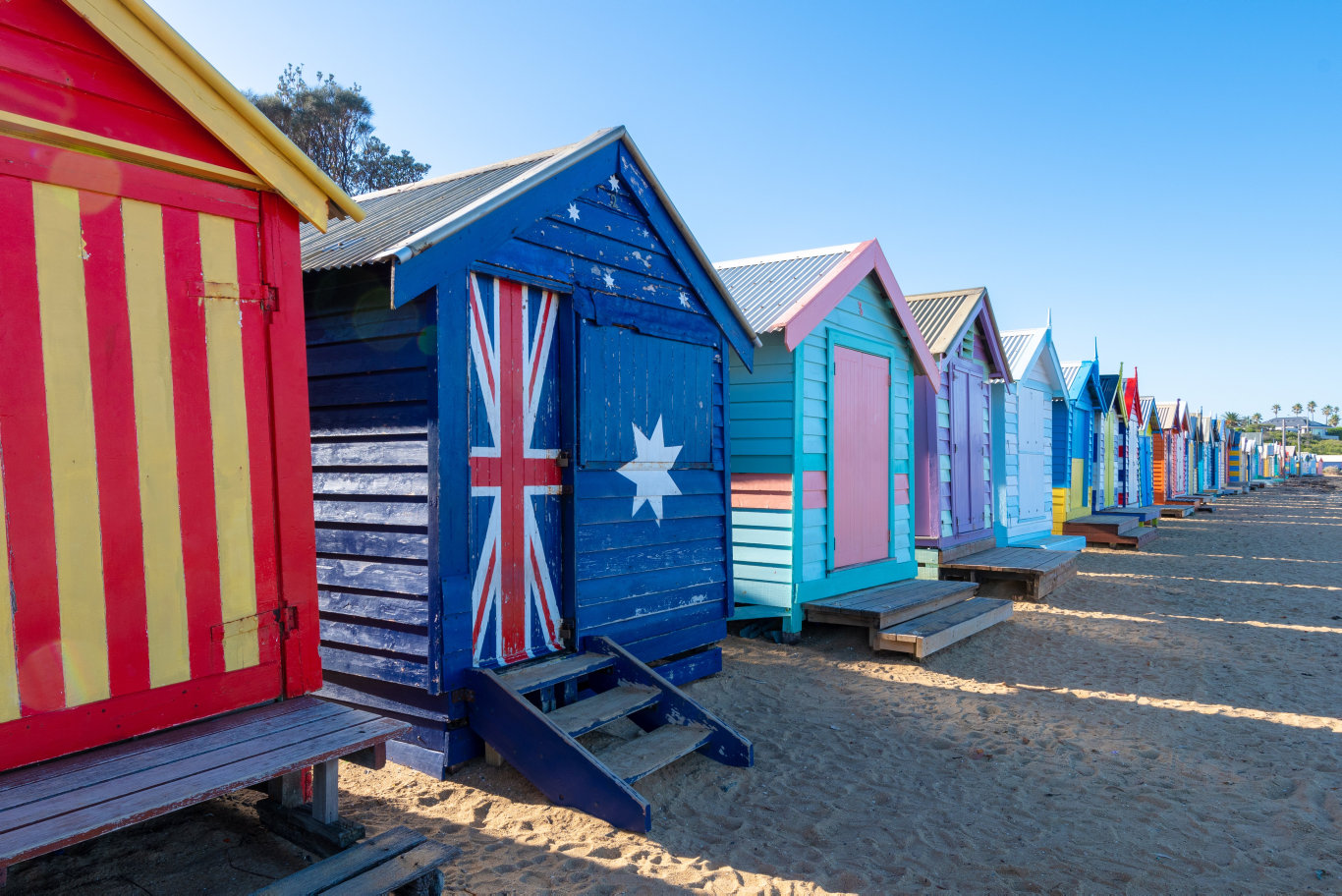 Bright and colourful wood beach bathing huts on Brighton Beach close to Melbourne, Australia.