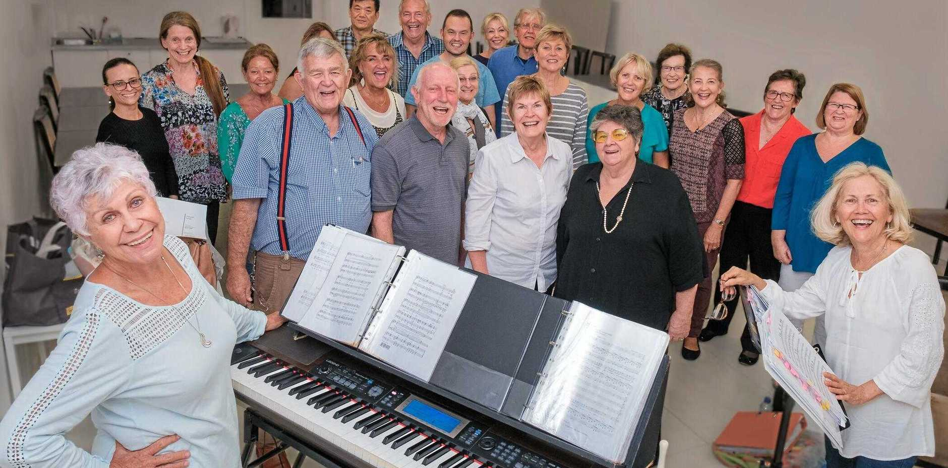 DROUGHT RELIEF CONCERT: Fasolati music director Mary Walters, conductor Anne Ryan, the original Fasolati group (front) Diana Dureau, Henk Steenhuis, Leigh and Jan Kealton, with some of the choir in rehearsal.