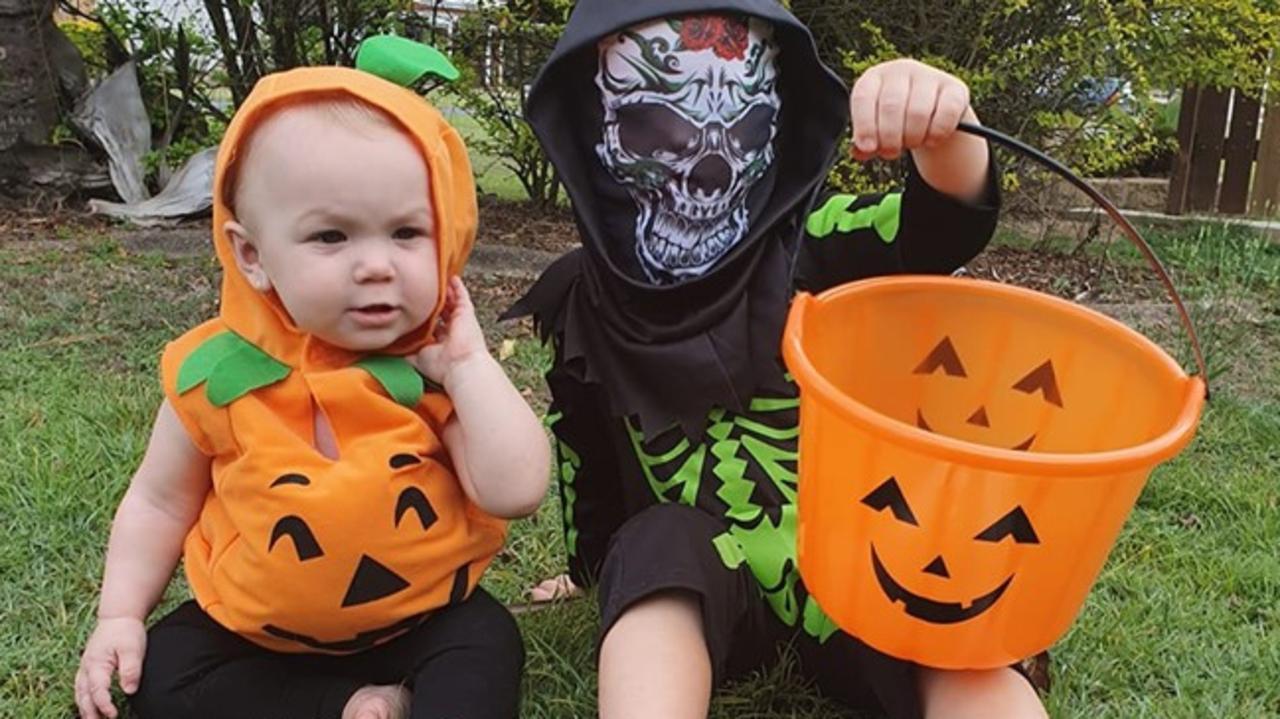 Little pumpkin Mackenzze, 11 months, and scary little skeleton Trinity, 4.