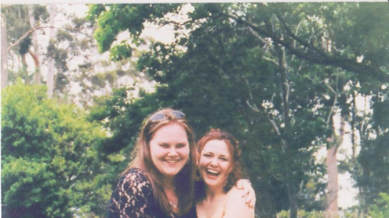 Kirra McLoughlin on her wedding day, pictured with her cousin Angela.
