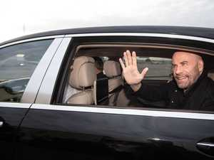 It's great to be back: Travolta jets into Australia