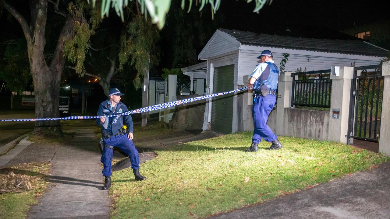 Police establish one of several crime scenes overnight.