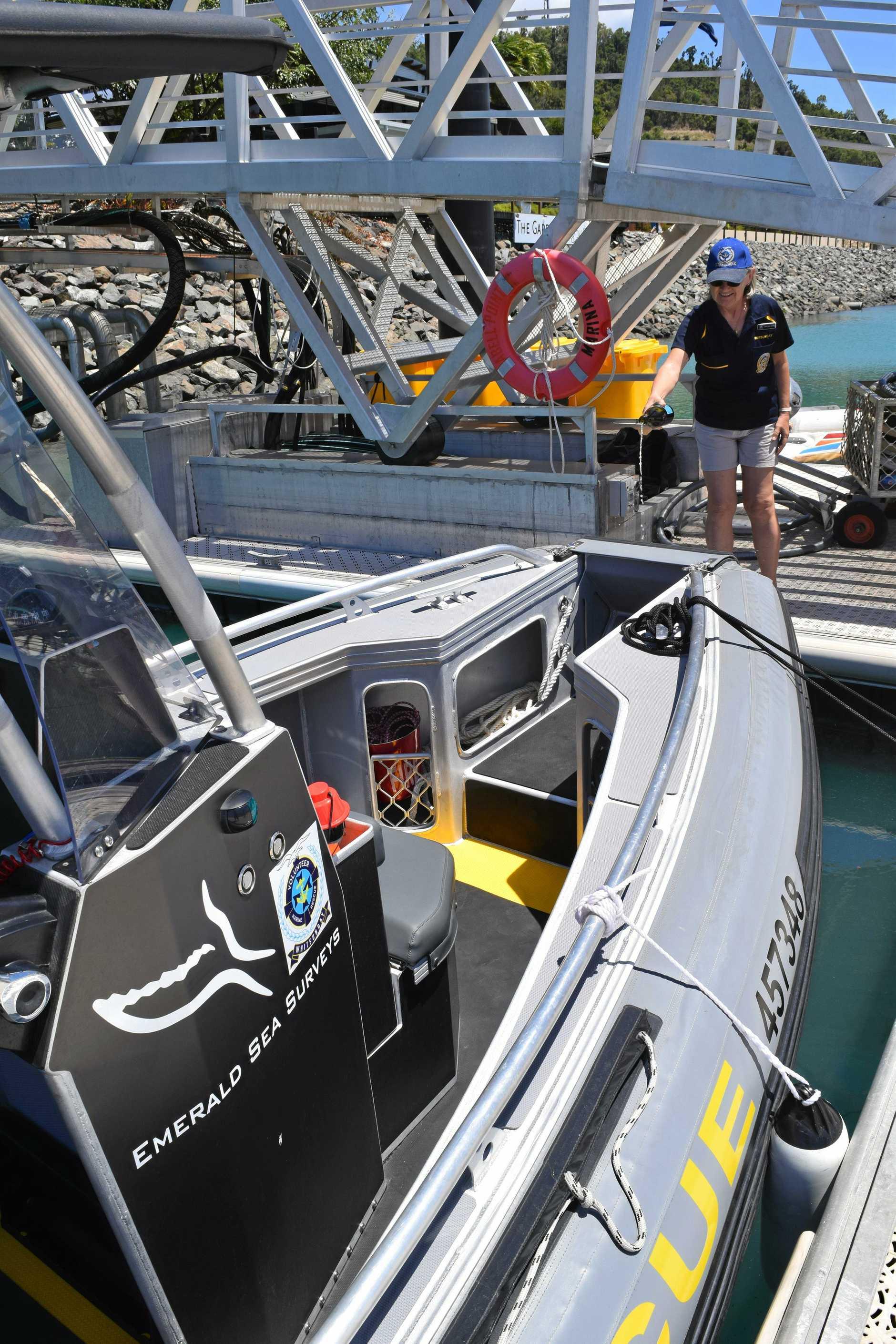 VMR Whitsunday committee member Marlene Manto christens the new VMR Whitsunday second boat.