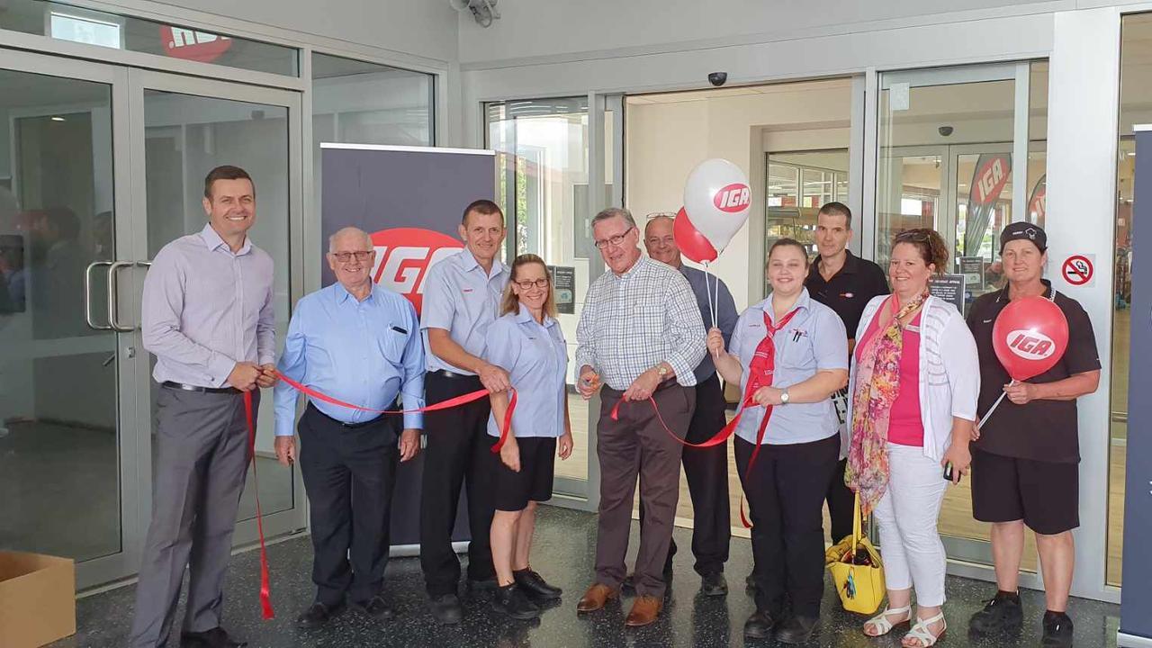 UNVEILED: South Burnett mayor cuts the ribbon to officially open the new refurbishment at Kingaroy's SUPA IGA supermarket.