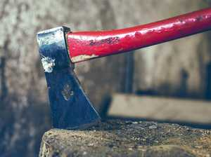 Woman armed with axe pours petrol on herself