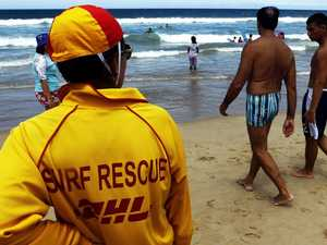 Woman pulled from water in near drowning at Coast beach