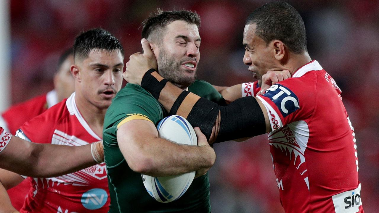 James Tedesco of Australia is tackled by William Hopoate of Tonga at Eden Park. Picture: AAP