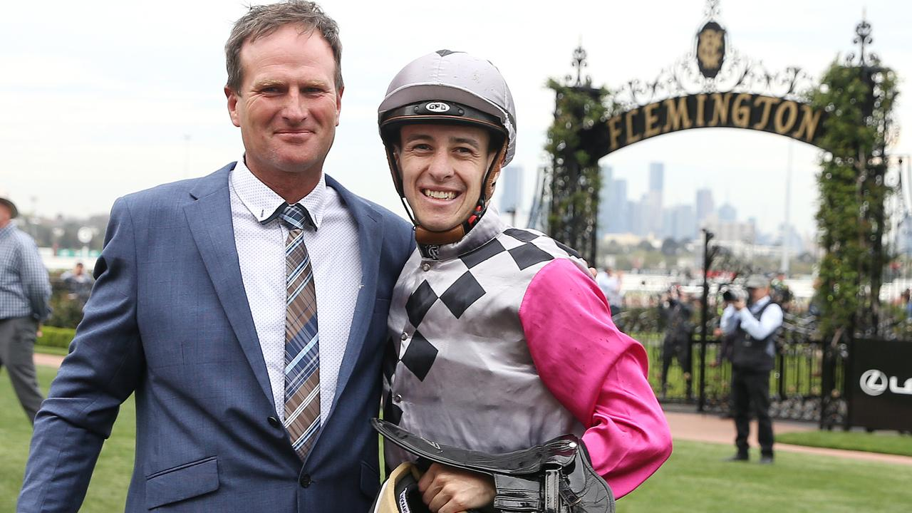 Surprise Baby jockey Jordan Childs and trainer Paul Preusker after winning The Bart Cummings and earning themselves a start in the Melbourne Cup. Picture: Michael Klein