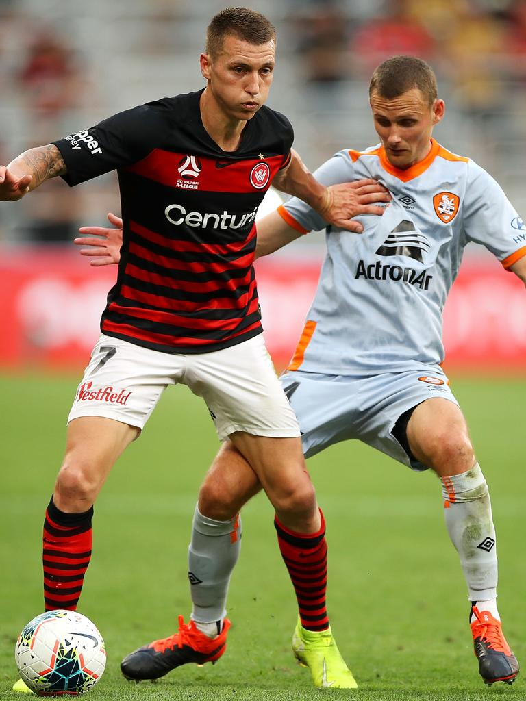 Wanderers' Mitchell Duke holds off Daniel Bowles. Picture: Getty Images
