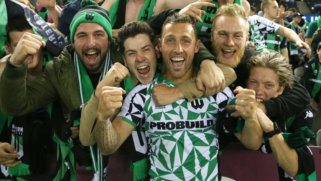 Scott McDonald celebrates his winner for Western United with adoring fans. Picture: AAP