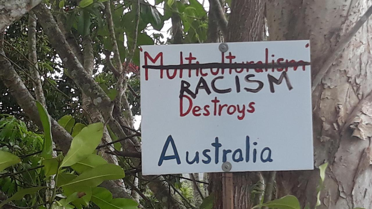 Sign erected at turn-off to Daintree Ferry, intersection of Mossman-Daintree Rd and Cape Tribulation Rd