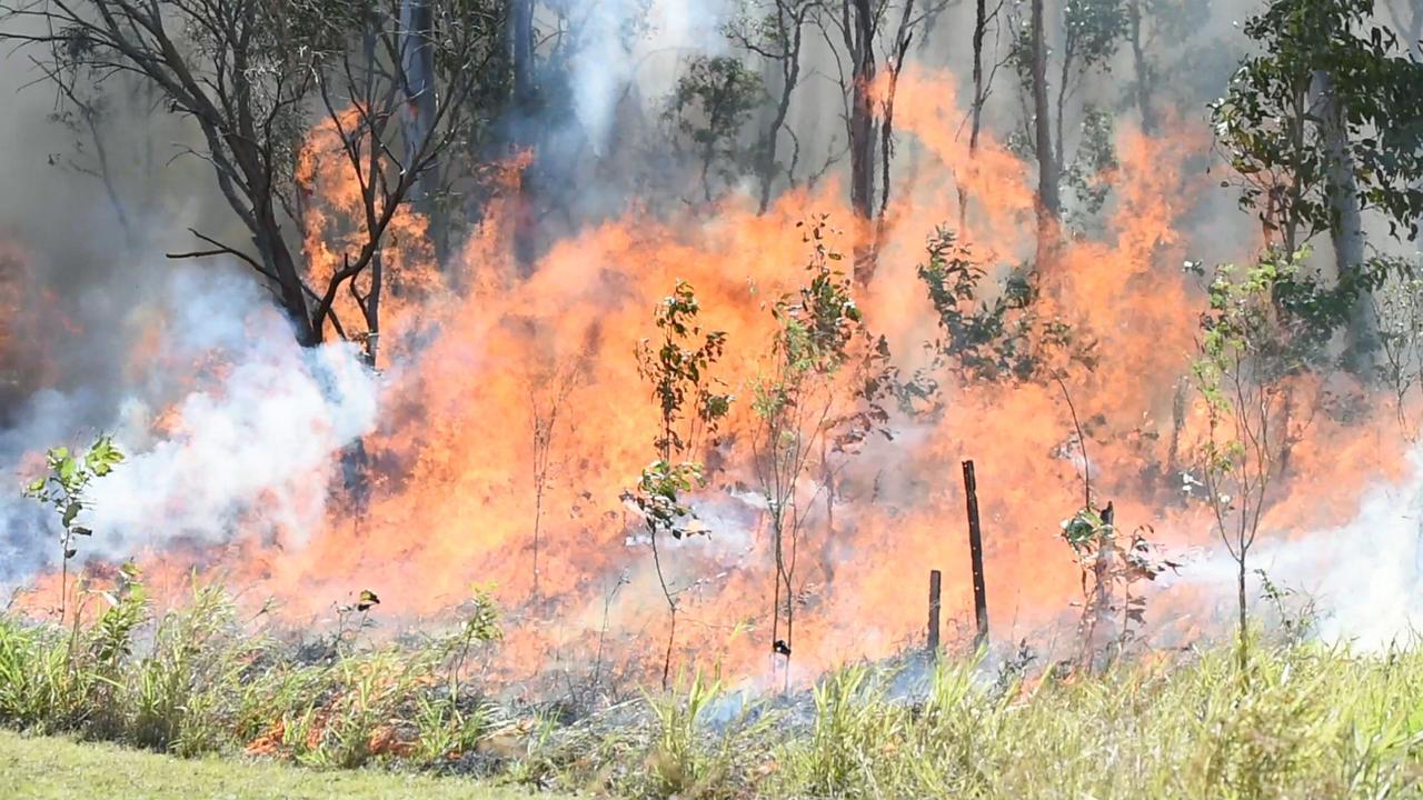 A fast-moving fire is burning through bushland near Kilcoy.