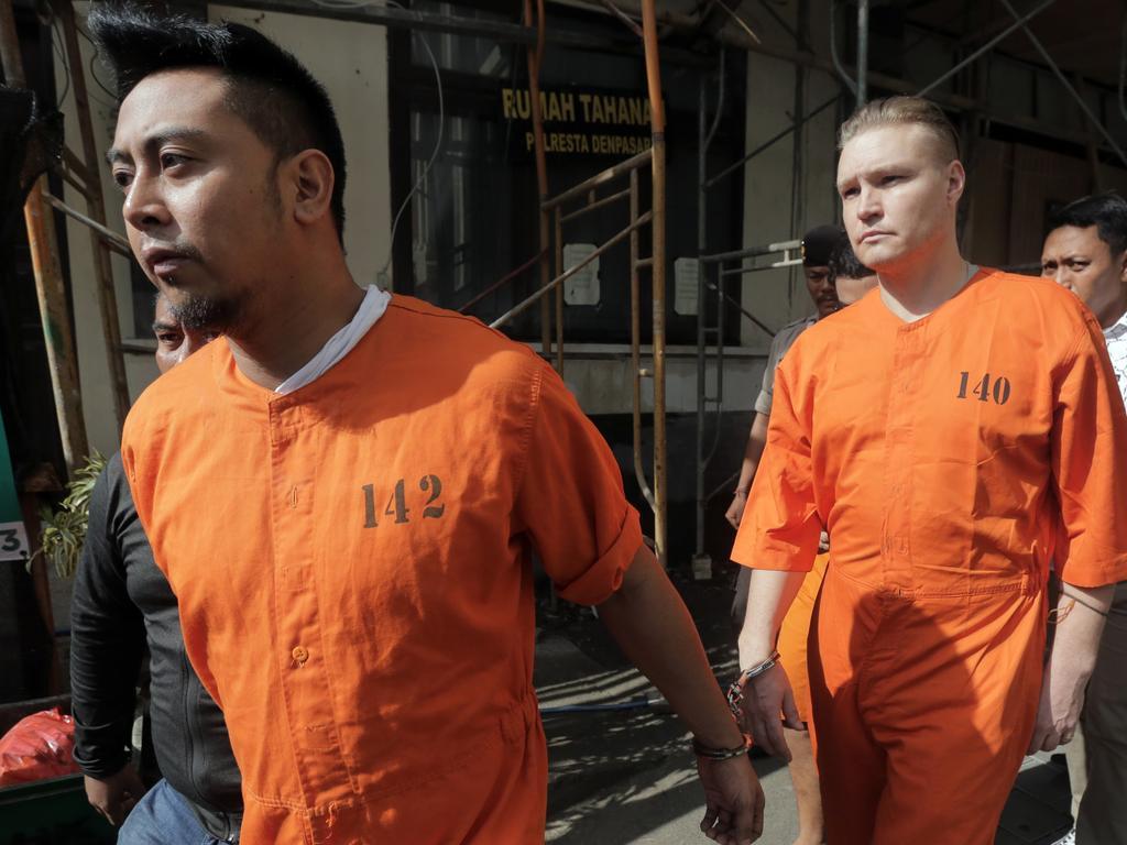 William Cabantog and David Van Iersel are handed over to prosecutors in Denpasar, Bali. Picture: Lukman S.Bintoro