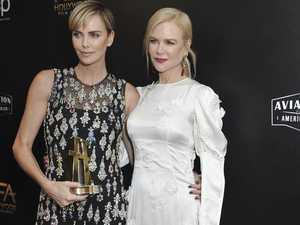 Nicole presents Charlize with major Hollywood award