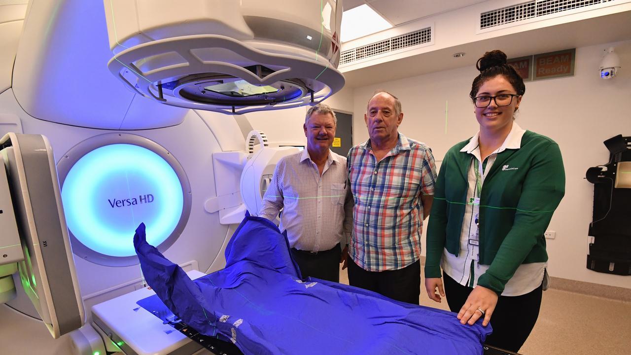 GenesisCare Hervey Bay - (L) Prof. Bryan Burmeister (Reg. Medical Dir.), patient Lenard Field and radiation therapist Gemma Wheeler with the Elekta Linear Accelerator.