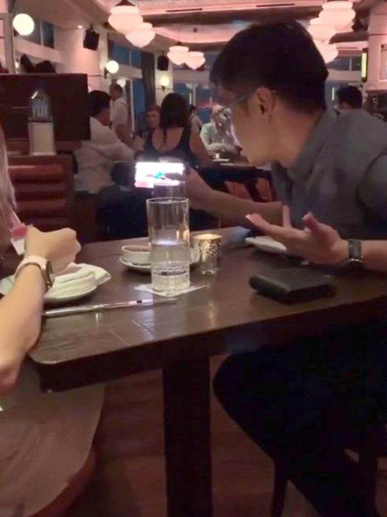 A couple at a neighbouring table feature in the video.
