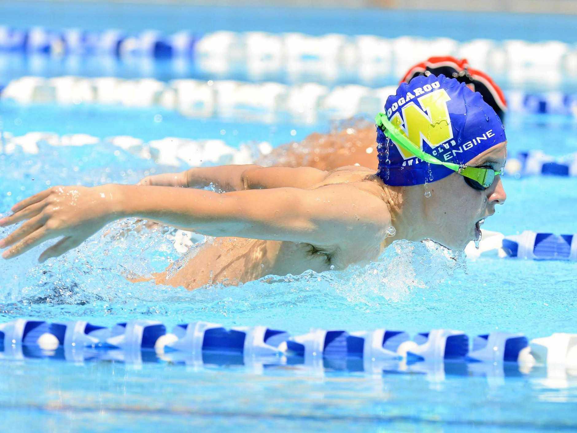 Woogaroo Swim club's Jordan Lane pushes himself in the 200m butterfly at the Bundamba Swim Centre.