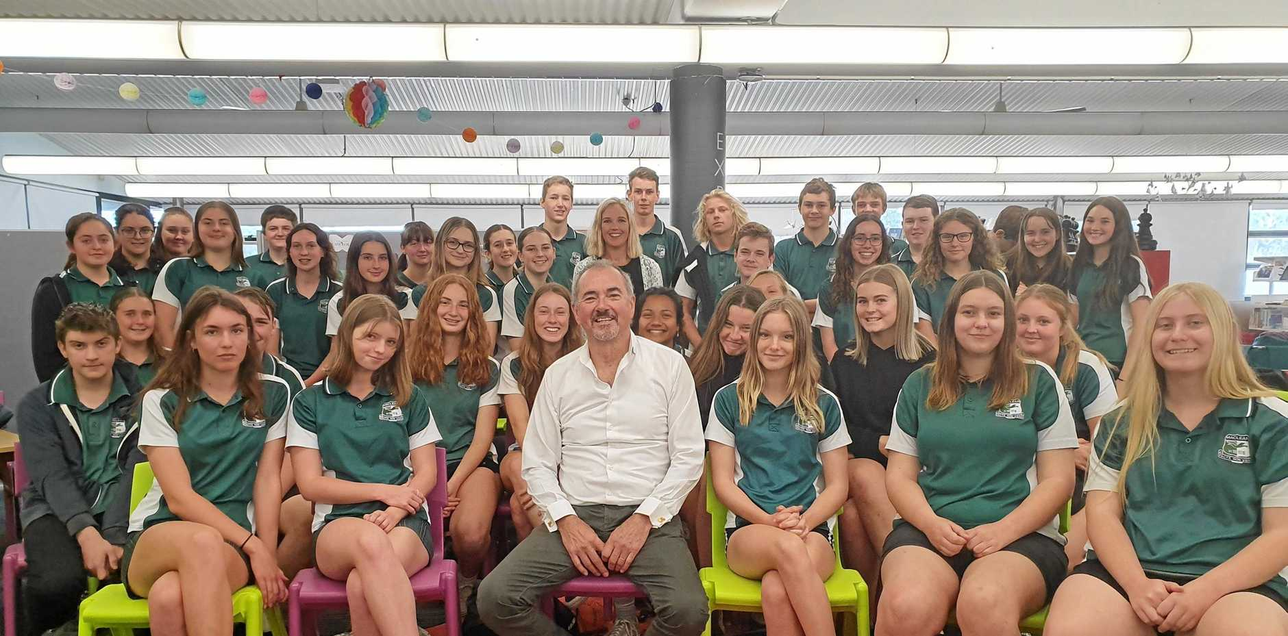 BUDDING BUSINESS LEADERS: Clarence MP Chris Gulaptis with some of Maclean High School's budding entrepreneurs and teacher Sarah Bramwell.