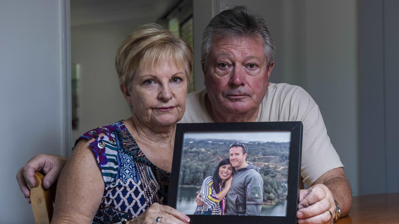 Rae and Colin Betts of Hervey Bay pose with a picture of their son Chris Betts and his wife Angela. Picture: John Wilson/The Australian