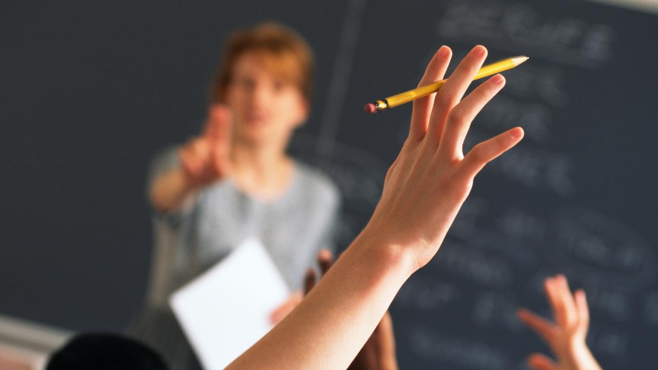 Hand Rasied in Classroom