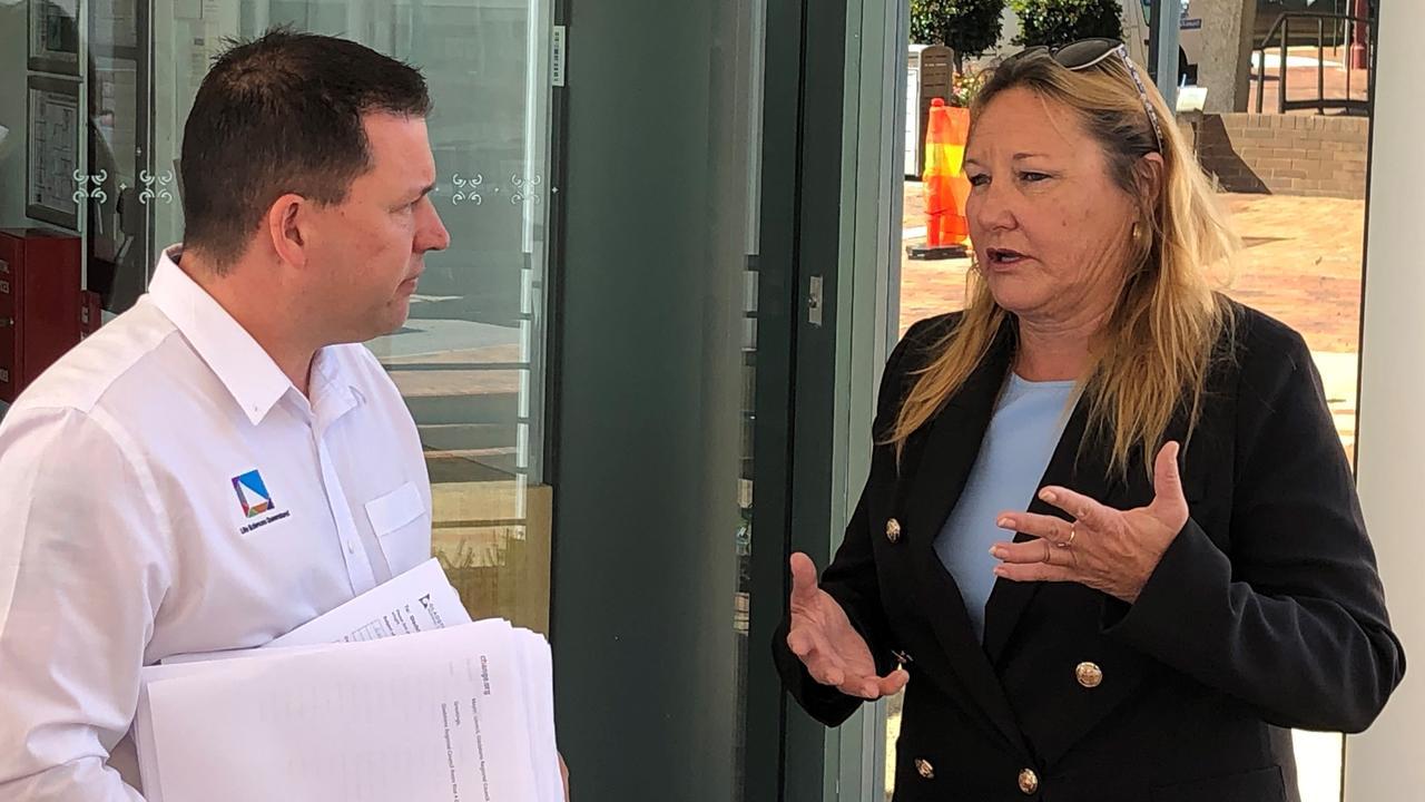 Mayor Matt Burnett receives a petition for a rates reduction and freeze from Jo-Ann Cuthbertson. PHOTO: Matt Harris