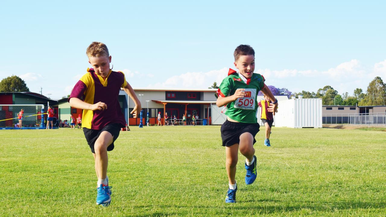 LITTLE ATHLETICS: Myles Mulholland & Jake Lloyd duke it out in the 100m sprint. Pic: Peta McEachern